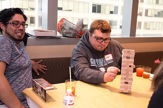 Students playing board games at the first year student spring dinner