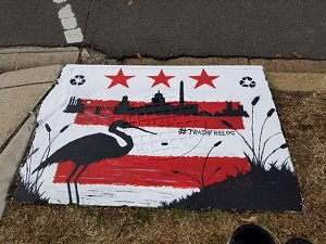 student finish storm drain project in DC