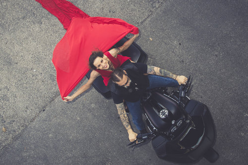 Lady in red on motorcycle