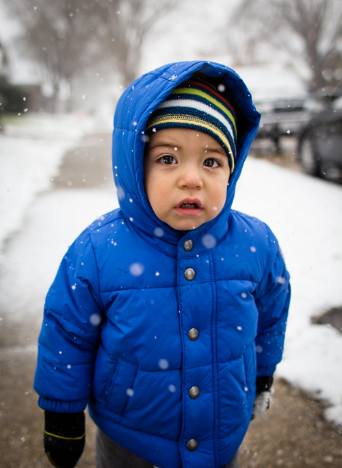 Boy in blue coat