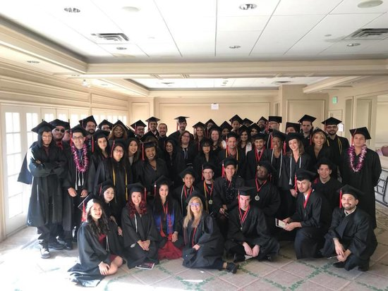 Design Graduates taking a group picture at Graduation
