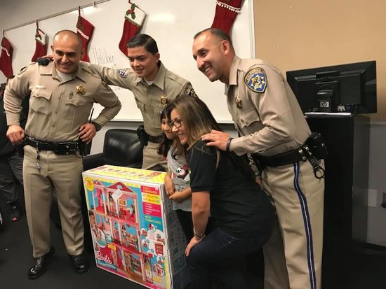 CHP Inland Division with Mattel handing out a Barbie Dream House