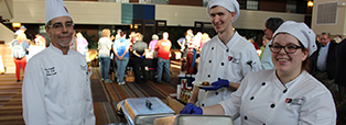 AiTN culinary students preparing food for a community event