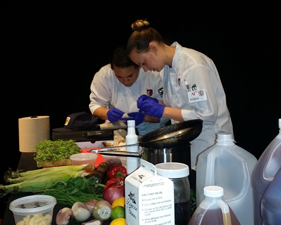 culinary arts students preparing food at the iron fork competition