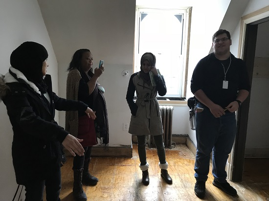 Interior Design students stand in room to be redesigned