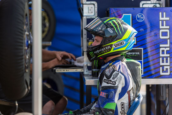 Professional rider waits in the pits after taking a spill