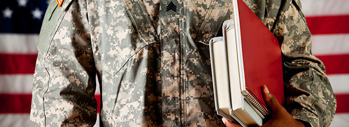 Military Person Carrying Books