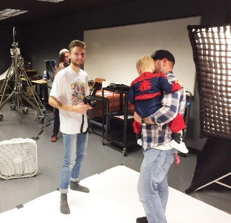 Digital Photography student Jameek Booth in the photo studio with Evan Brauch as Spiderman and his dad, Kyle Brauch.