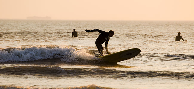 The Art Institute of Virginia Beach Student Surfing
