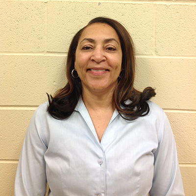 Physical Education Instructor and Award-Winning Coach of Girls' Basketball Team