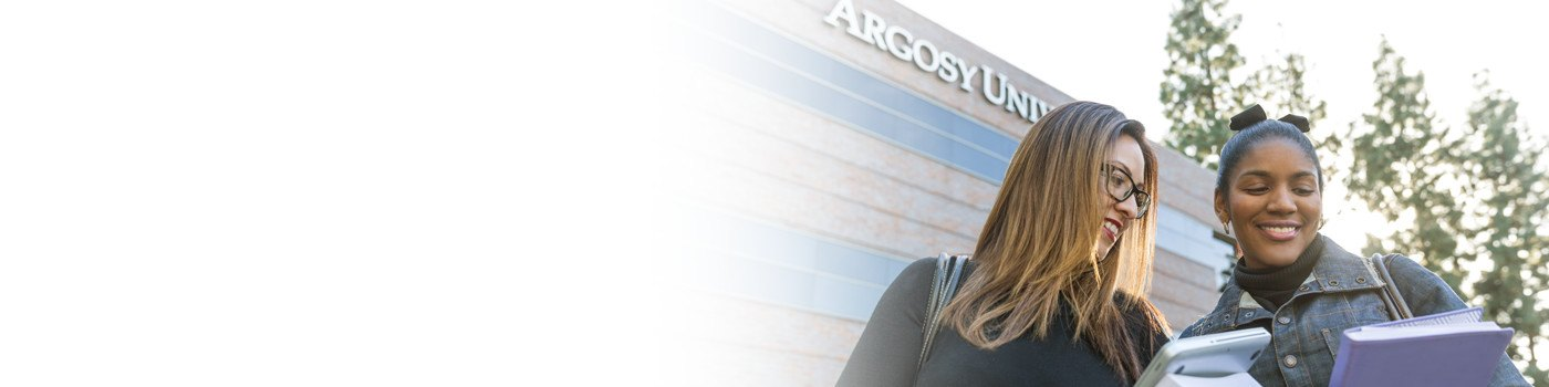 Two students standing outside of Argosy University