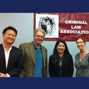 Four people standing in front of Criminal Law Association