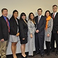 People with law review symposium