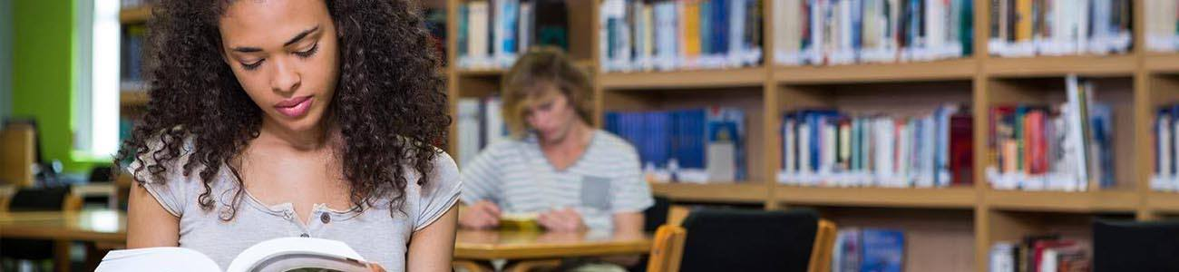 Student studies at library