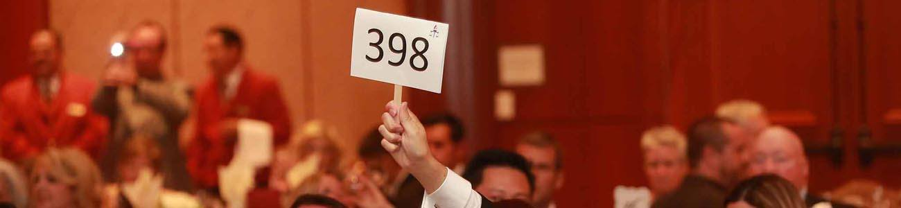 Guy holds up a number